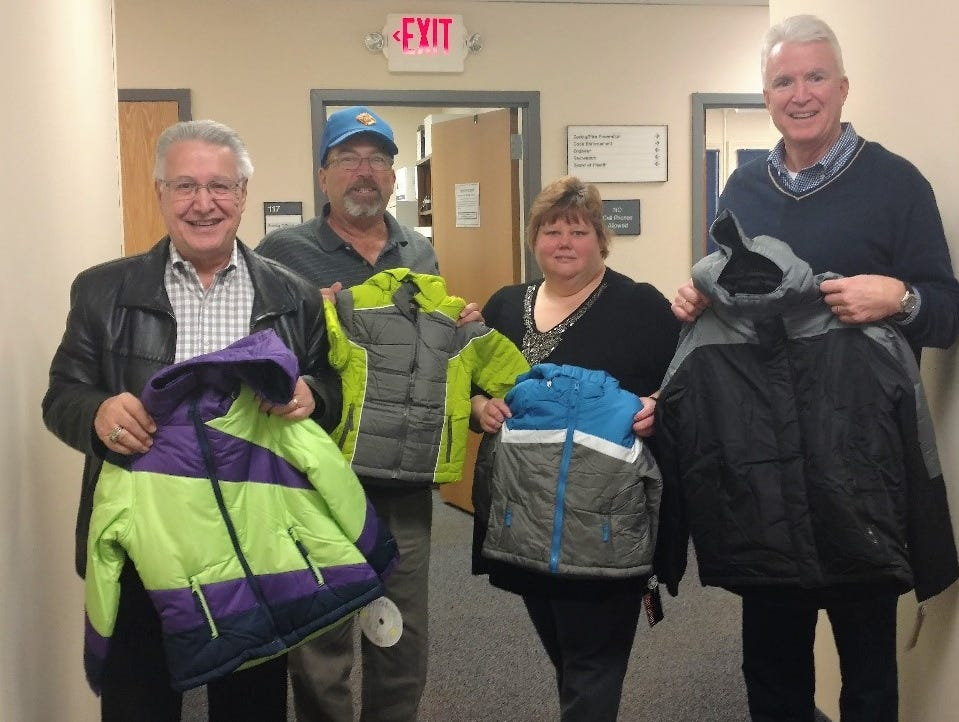 On Nov. 20, Knights of Columbus Council #15540 donated 48 new winter coats to Christine Dey of the Readington Township Housing and Social Services in support of Coats for Kids. Pictured with Dey at the Readington Township Municipal building (from left to right) are Financial Secretary Frank Renda, Trustee Walter Urban and Grand Knight Tim Connolly.