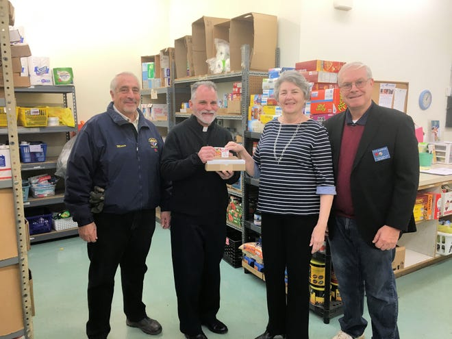 Rev. James Kyrpczak, St. Joseph Church, and High Bridge Knights Mario Bernardo and Steve Bauernfeind present $2,800 in ShopRite Gift Cards to Anne Underhill, executive director of the Open Cupboard Food Pantry in Clinton. The ShopRite Gift Cards were purchased using donations from St. Joseph parishioners and from the Knights and will be distributed to food pantry clients during the Christmas Season.