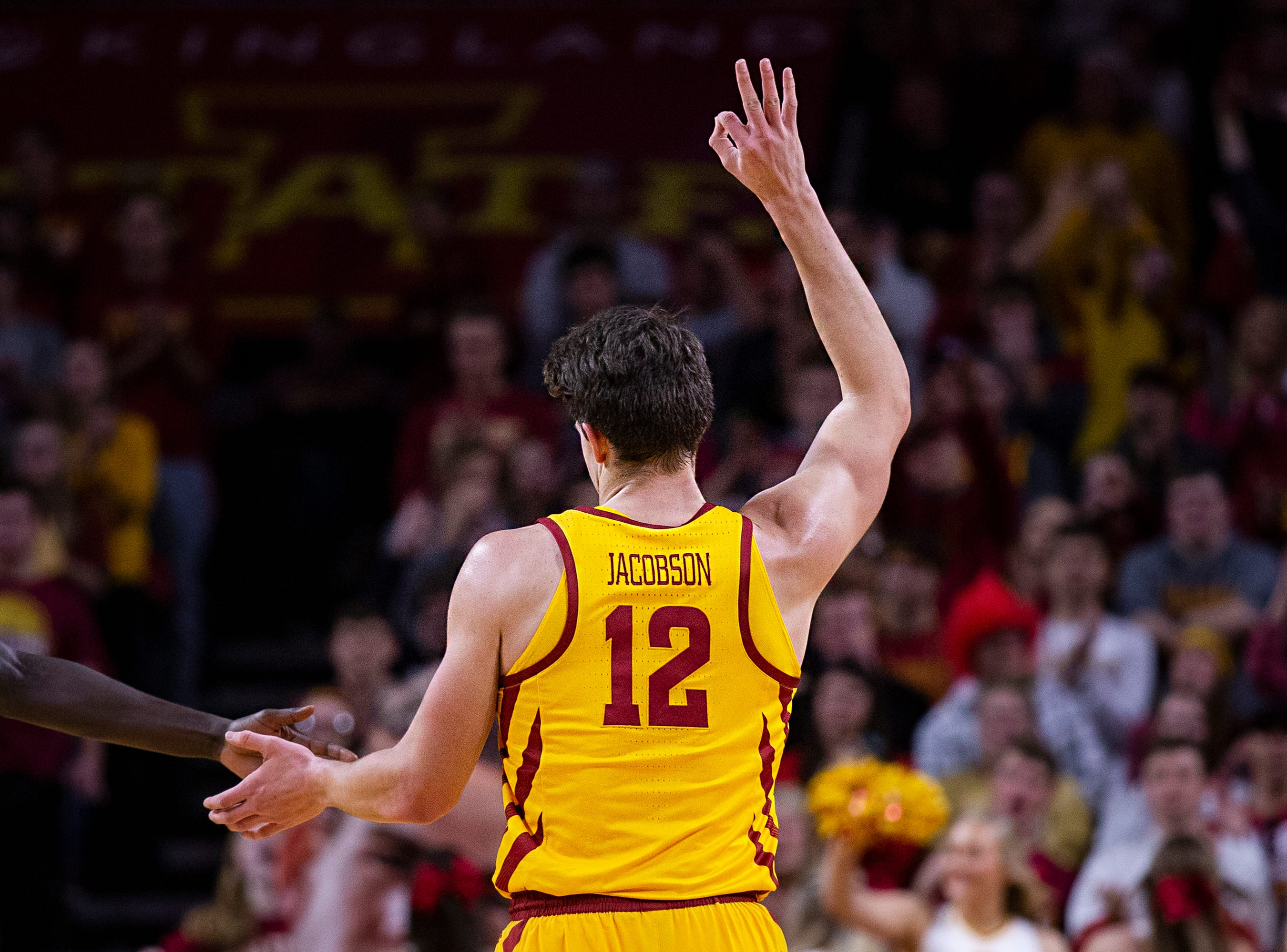Iowa State's Michael Jacobson celebrates scoring three points during the Iowa State men's basketball game against North Dakota State University on Monday, Dec. 3, 2018, in Hilton Coliseum.