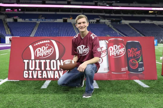 Caleb Line, of Nashua, won $100,000 in tuition after beating another finalist on Saturday at the Lucas Oil Stadium in Indianapolis by throwing the most footballs into a giant Dr. Pepper can in 30 seconds.