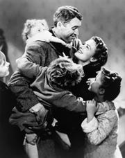 """Jimmy Stewart, center, and Donna Reed appear in a scene from Frank Capra's 1946 holiday classic, """"It's A Wonderful Life."""""""