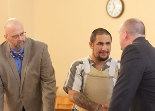 Zachary Koehn, center, shakes hands with defense attorney Les Blair III, right, following sentencing. Also pictured is defense attorney Steven Drahozal.