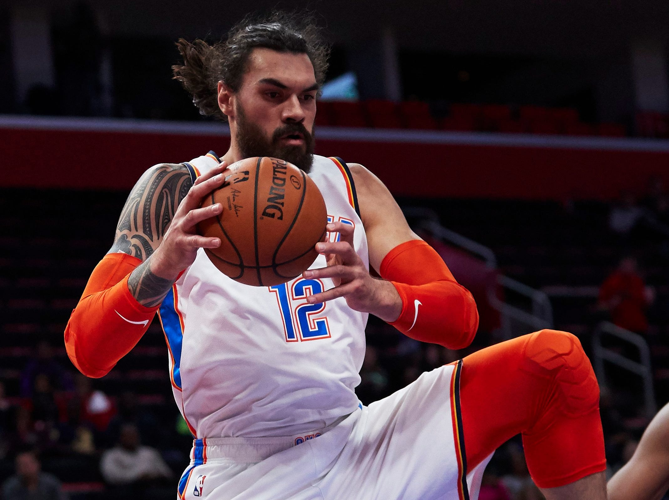 Oklahoma City Thunder center Steven Adams (12) grabs the rebound in the first half against the Detroit Pistons at Little Caesars Arena.