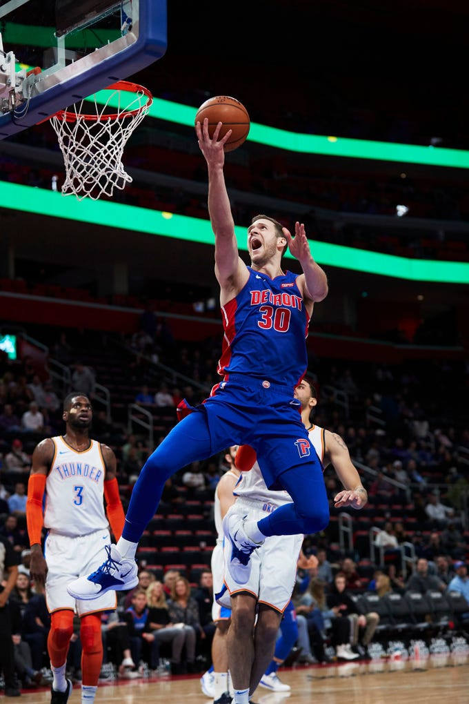 Detroit Pistons forward Jon Leuer (30) shoots in the second half against the Oklahoma City Thunder at Little Caesars Arena.