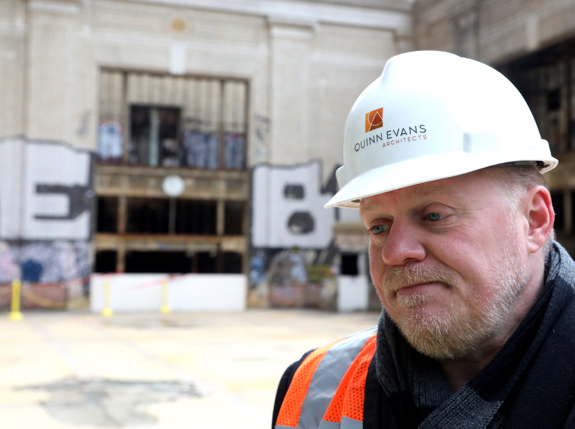 Richard Hess, from Quinn Evans Architects, talks with the media during a tour of Michigan Central Station in Detroit on Tuesday, December 4, 2018.