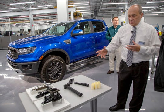 Harold Sears, technical expert, rapid manufacturing/additive manufacturing technologies for Ford Motor, shows 3D parts used in the manufacturing of the Ford Ranger at the Advanced Manufacturing Center for Ford in Redford Township on Tuesday, Dec. 4, 2018.