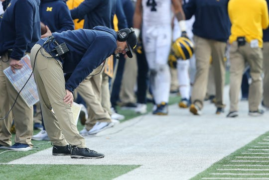 Michigan coach Jim Harbaugh reacts as time winds down in the 62-39 loss to Ohio State at Ohio Stadium, Nov. 24, 2018 in Columbus, Ohio.