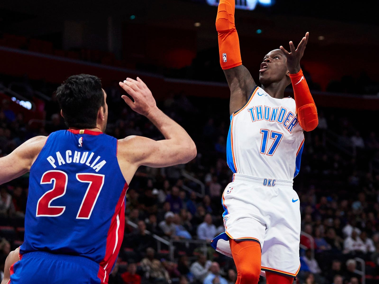 Oklahoma City Thunder guard Dennis Schroder (17) shoots on Detroit Pistons center Zaza Pachulia (27) in the first half at Little Caesars Arena.