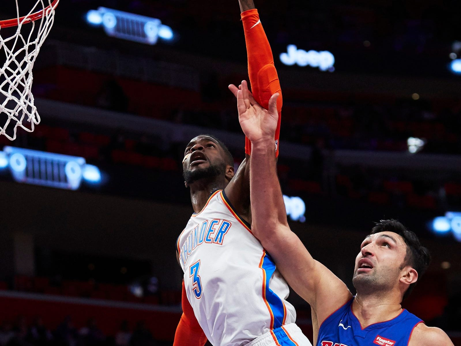 Oklahoma City Thunder forward Nerlens Noel (3) shoots defended by Detroit Pistons center Zaza Pachulia (27) in the first half at Little Caesars Arena.