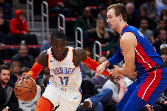 Oklahoma City Thunder guard Dennis Schroder (17) dribbles defended by Detroit Pistons guard Luke Kennard (5) in the first half at Little Caesars Arena.