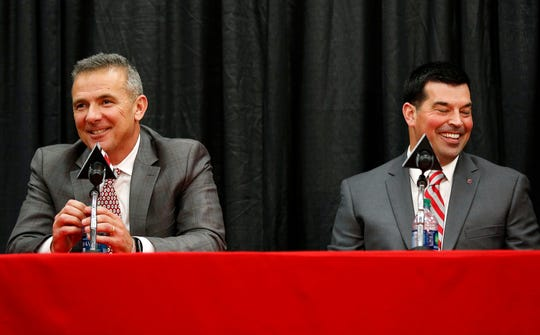 Ohio State coach Urban Meyer (left) addresses members of the media to announce his intentions to step down from coaching after the Rose Bowl game. New head coach Ryan Day is at right, during the news conference Tuesday, Dec. 4, 2018, in Columbus, Ohio.