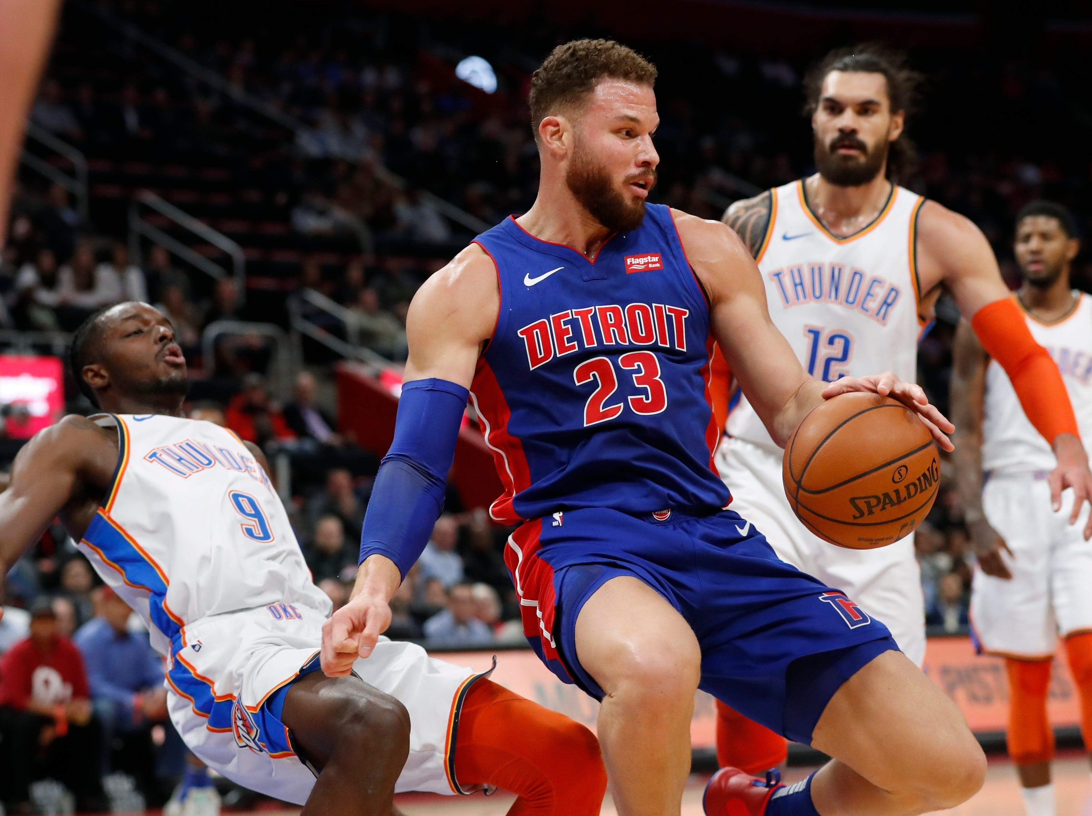Detroit Pistons forward Blake Griffin (23) fouls Oklahoma City Thunder forward Jerami Grant (9) during the first half of an NBA basketball game, Monday, Dec. 3, 2018, in Detroit.