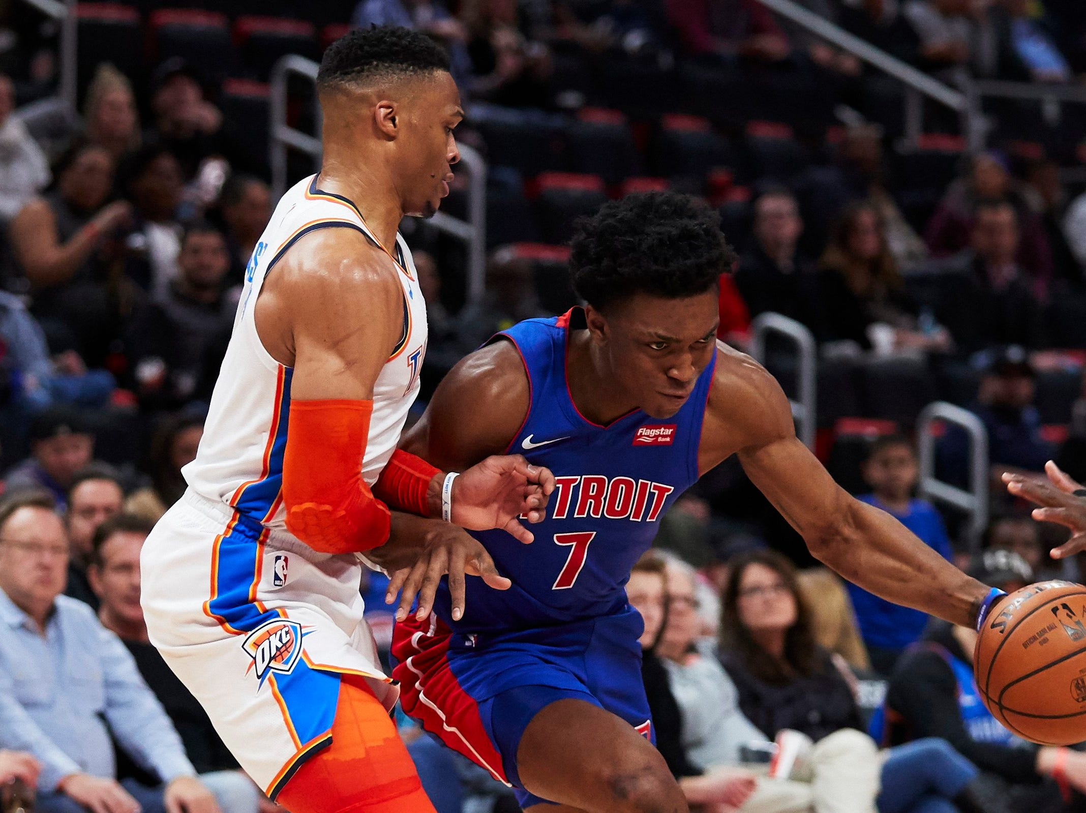 Detroit Pistons forward Stanley Johnson (7) dribbles defended by Oklahoma City Thunder guard Russell Westbrook (0) in the second half at Little Caesars Arena.
