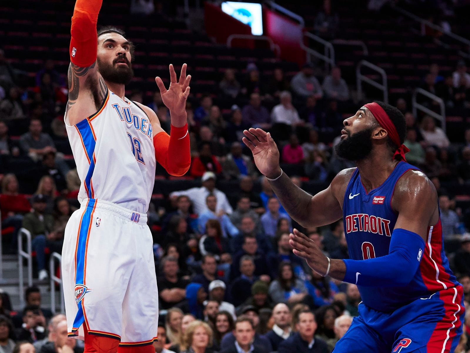 Oklahoma City Thunder center Steven Adams (12) shoots on Detroit Pistons center Andre Drummond (0) in the first half at Little Caesars Arena.