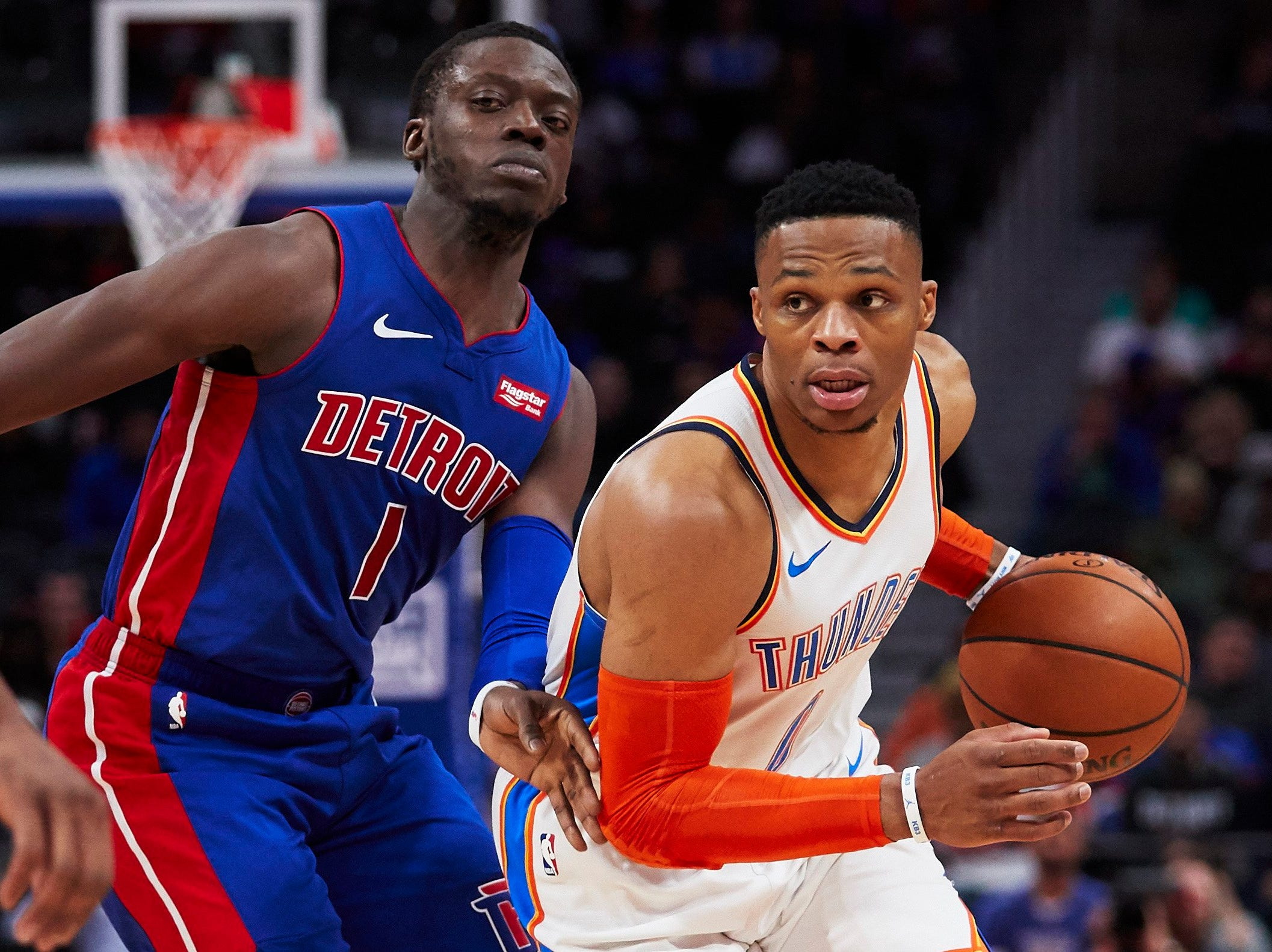 Oklahoma City Thunder guard Russell Westbrook (0) defended by on Detroit Pistons guard Reggie Jackson (1) in the first half at Little Caesars Arena.