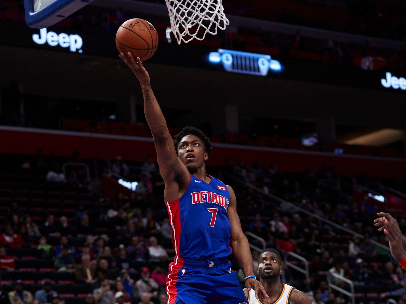 Detroit Pistons forward Stanley Johnson (7) goes to the basket on Oklahoma City Thunder forward Paul George (13) in the second half at Little Caesars Arena.