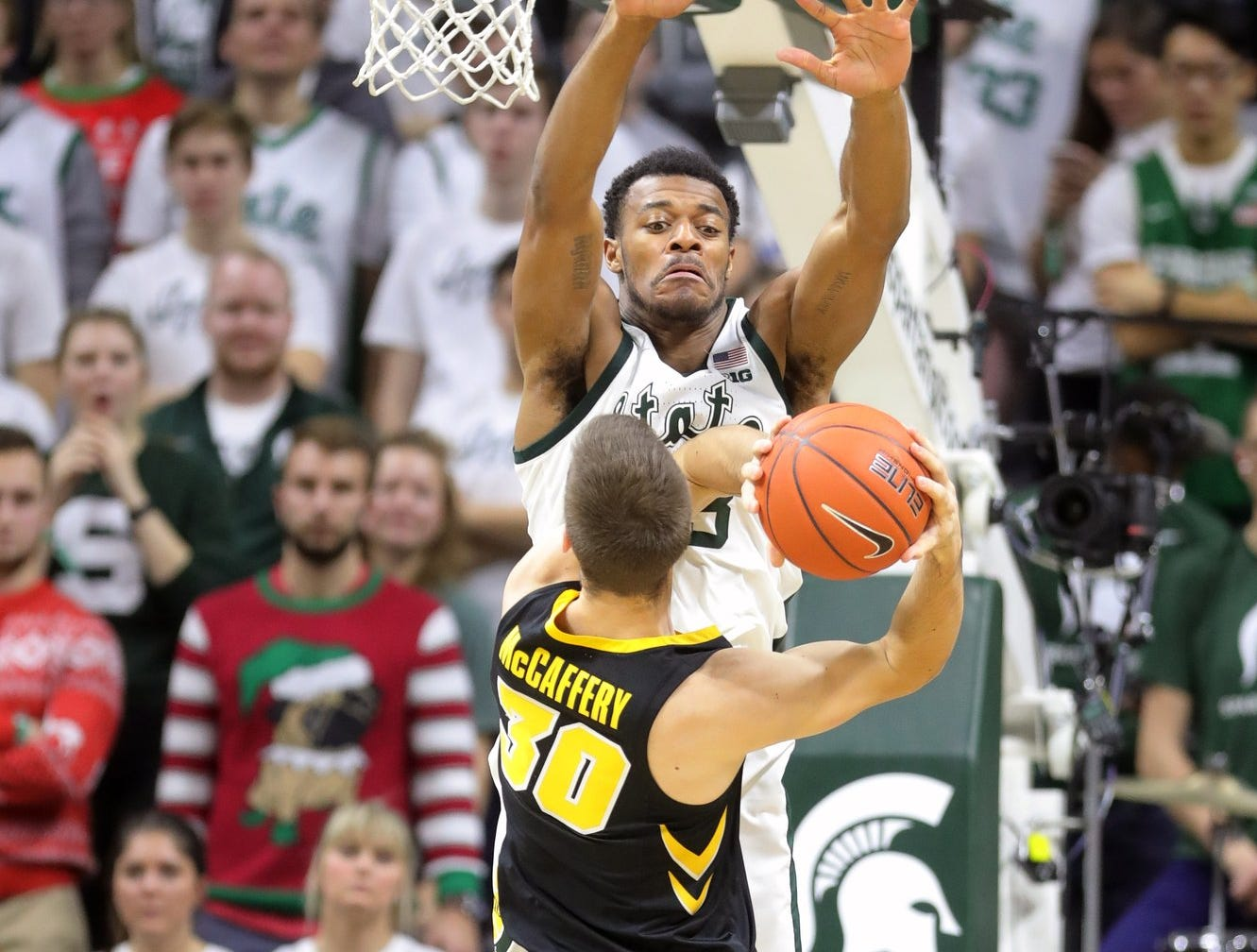 Michigan State forward Xavier Tillman defends against Iowa guard Connor McCaffery during second half action Monday, December 3, 2018 at the Breslin Center in East Lansing, Mich.