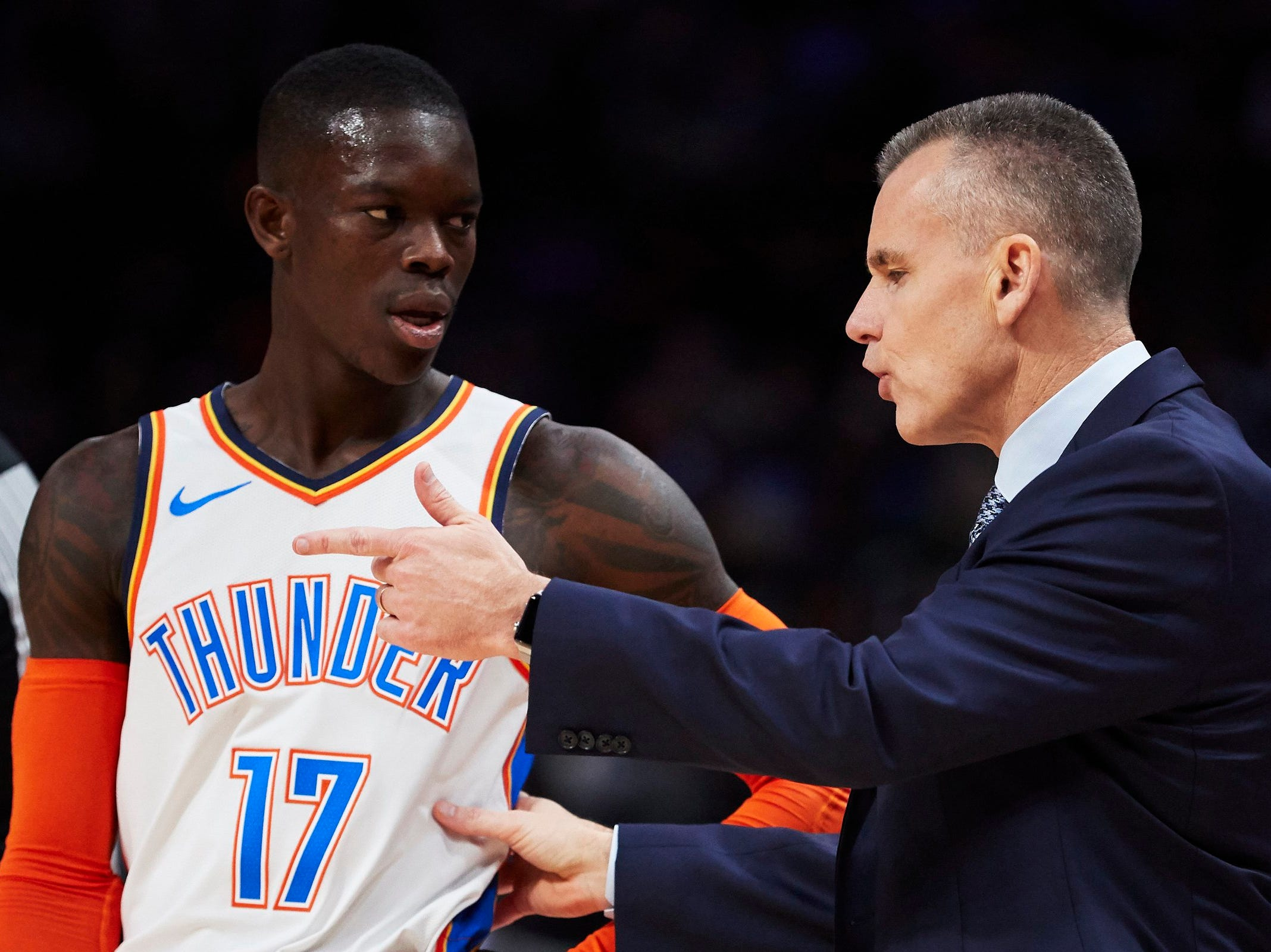 Oklahoma City Thunder head coach Billy Donovan talks to guard Dennis Schroder (17) during the second half against the Detroit Pistons at Little Caesars Arena.