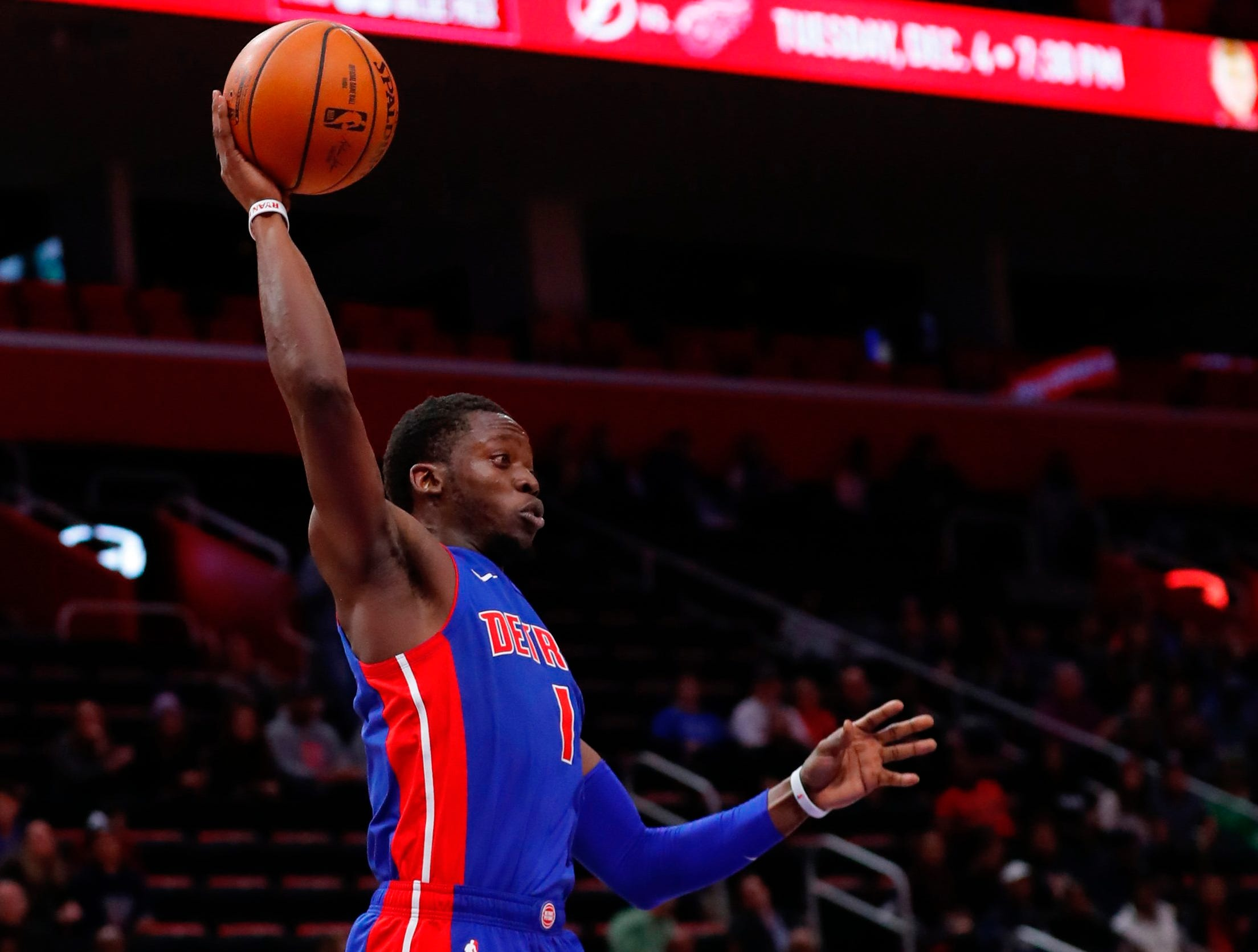 Detroit Pistons guard Reggie Jackson (1) grabs a rebound in the first half against the Oklahoma City Thunder at Little Caesars Arena.