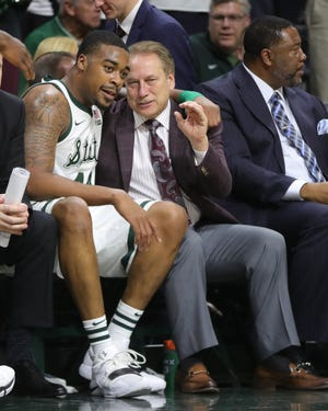 Michigan State head coach Tom Izzo and Nick Ward on the bench during second half action against Iowa Monday, December 3, 2018 at the Breslin Center in East Lansing, Mich.