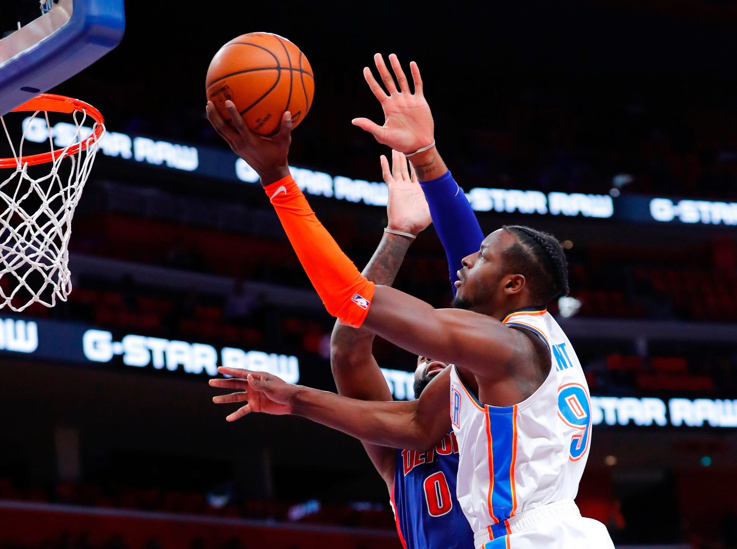 Oklahoma City Thunder forward Jerami Grant (9) goes to the basket on Detroit Pistons center Andre Drummond (0) in the first half at Little Caesars Arena.