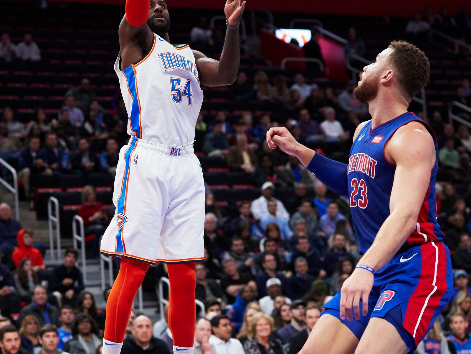 Oklahoma City Thunder forward Patrick Patterson (54) shoots over Detroit Pistons forward Blake Griffin (23) in the first half  at Little Caesars Arena.