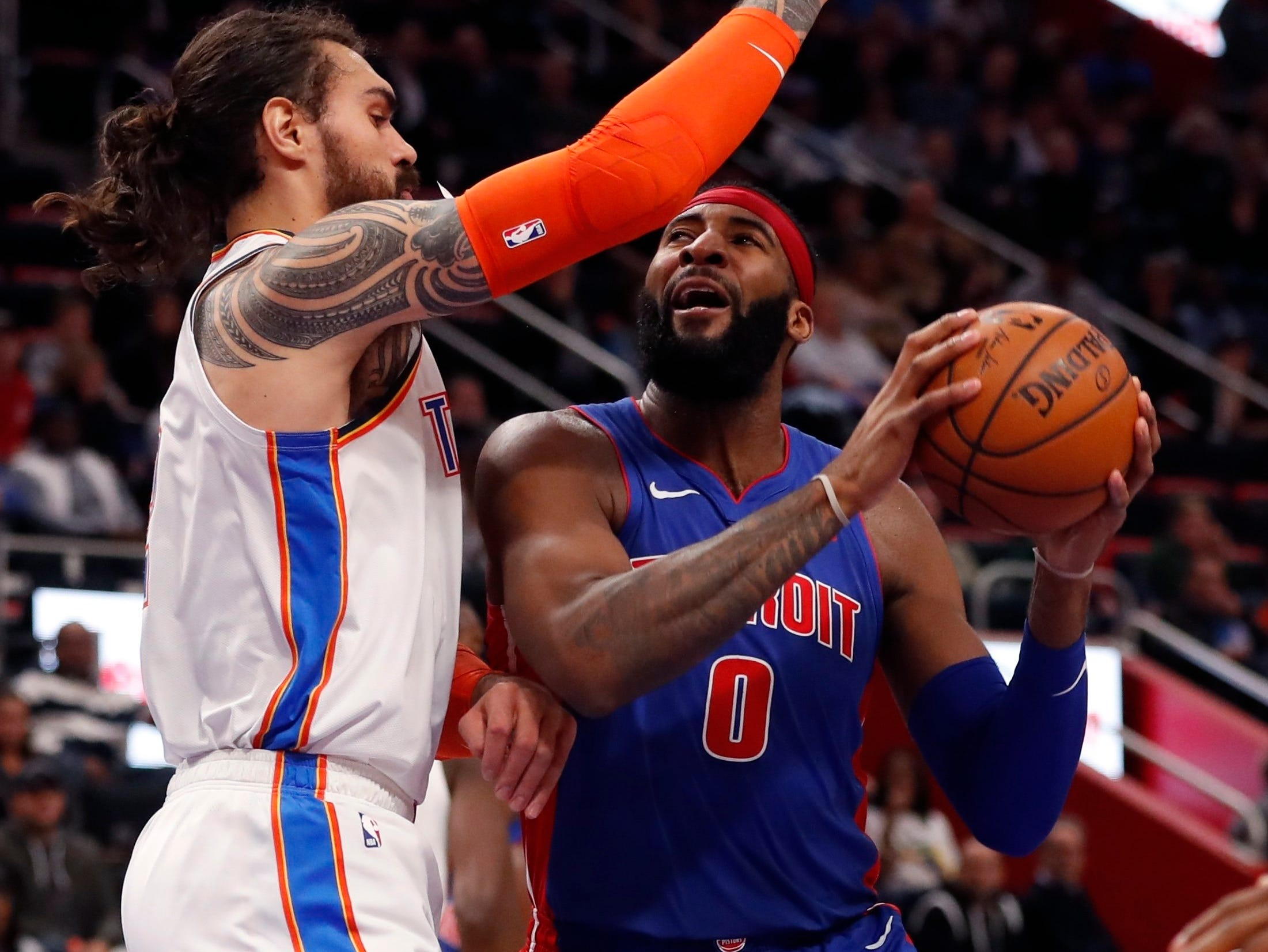 Detroit Pistons center Andre Drummond (0) is defended by Oklahoma City Thunder center Steven Adams during the first half of an NBA basketball game, Monday, Dec. 3, 2018, in Detroit.