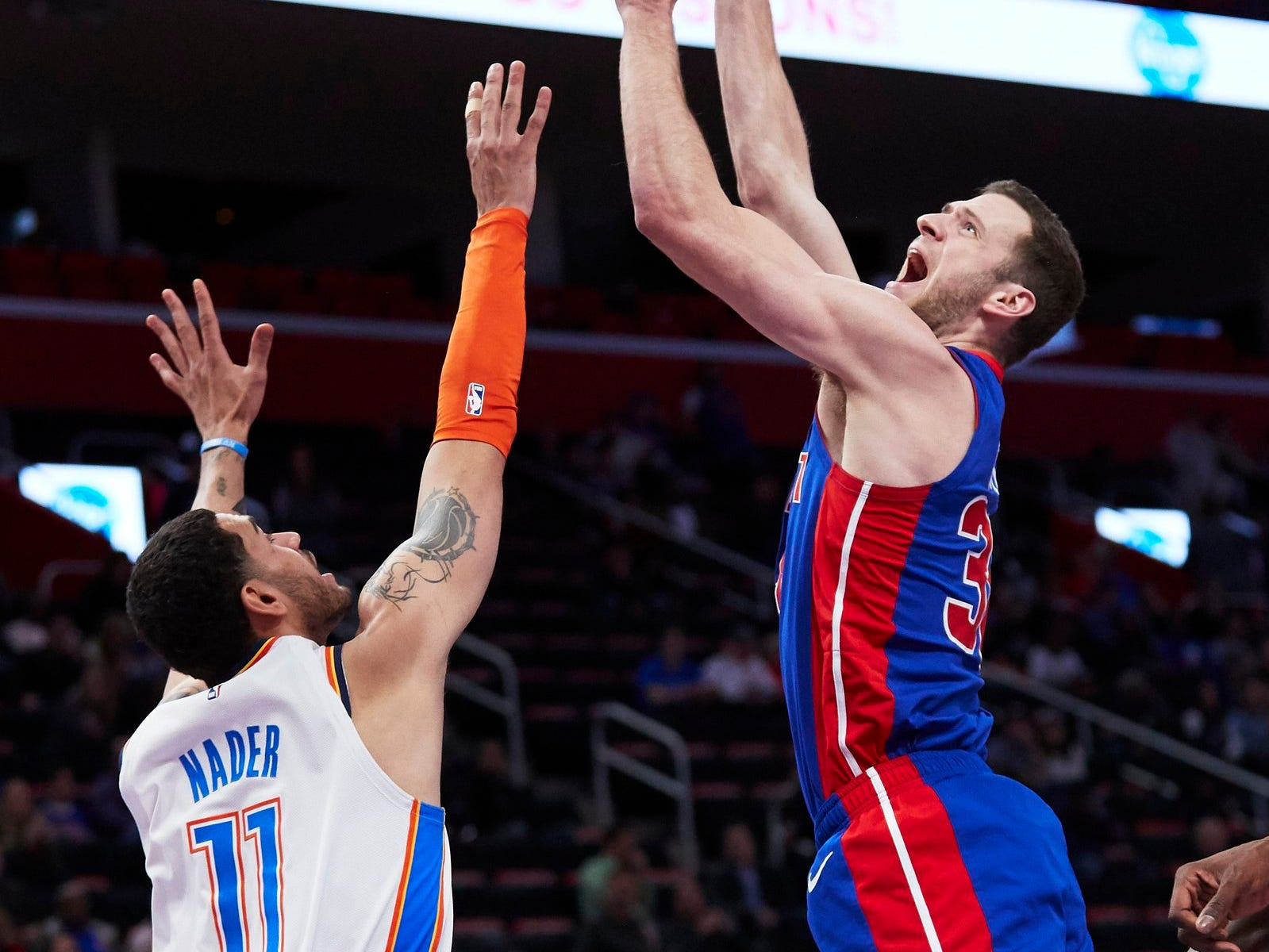 Detroit Pistons forward Jon Leuer (30) shoots on Oklahoma City Thunder forward Abdel Nader (11) in the second half at Little Caesars Arena.