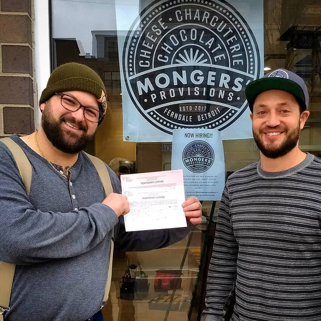 From left, Zach Berg and William Werner, with a license from the State of Michigan. They are in front of Mongers' Provisions, their second specialty retail shop located in Detroit.