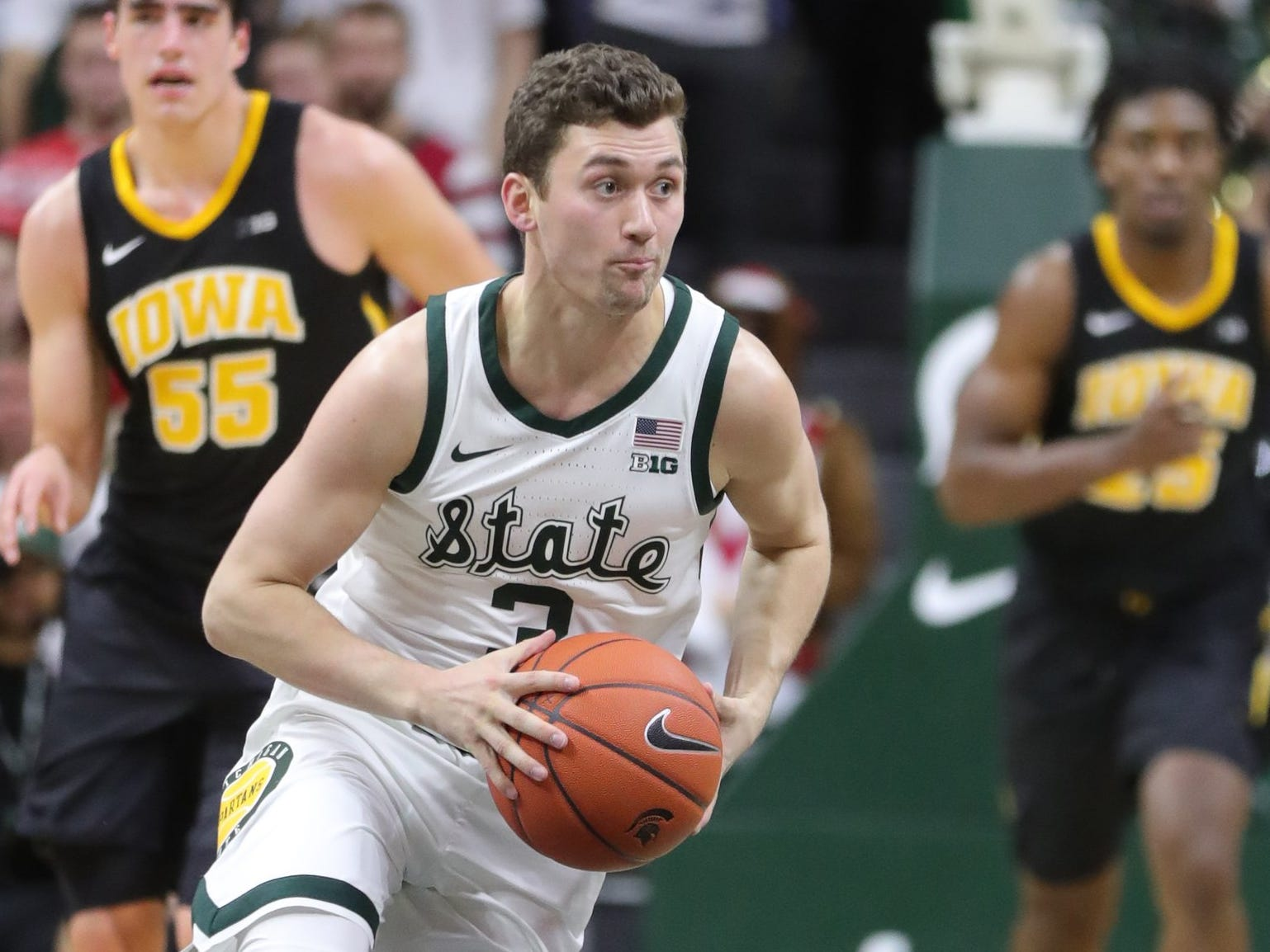 Michigan State guard Foster Loyer passes against Iowa  during second half action Monday, December 3, 2018 at the Breslin Center in East Lansing, Mich.