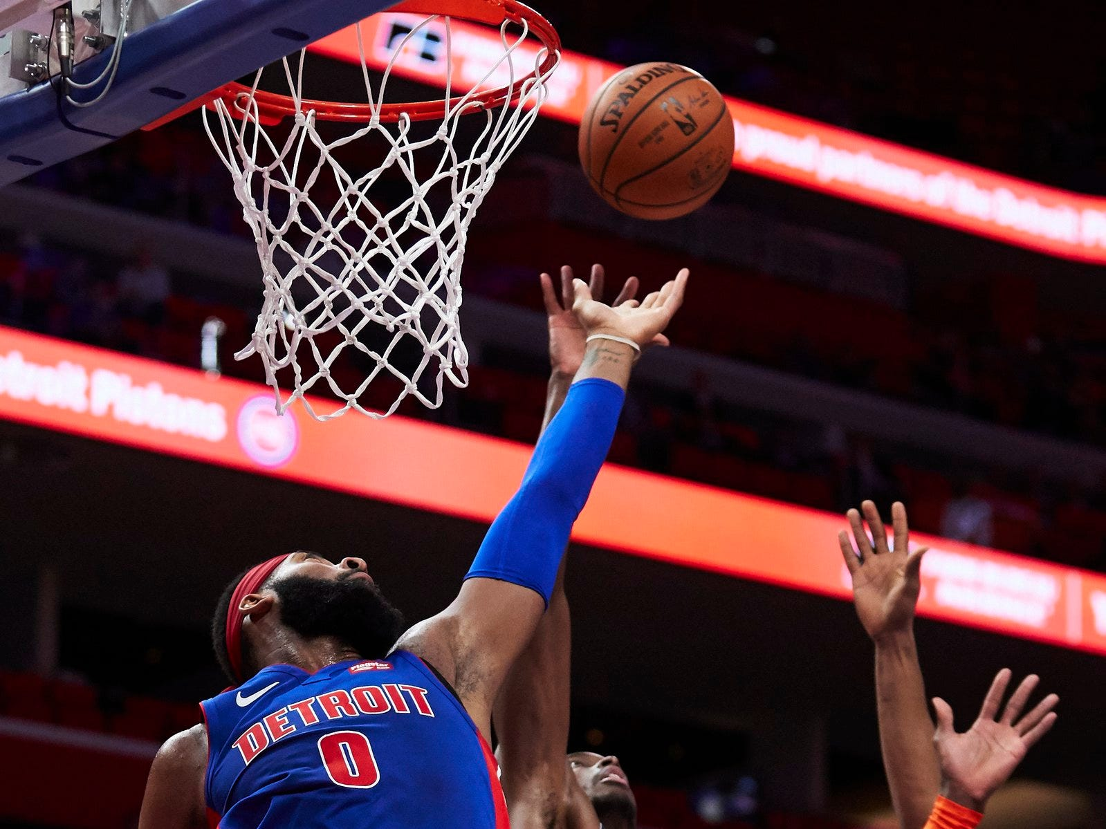 Detroit Pistons center Andre Drummond (0) and Oklahoma City Thunder forward Jerami Grant (9) goes for the rebound in the second half at Little Caesars Arena.
