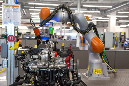A demonstration of a collaborative robot in action inspecting an engine at the Advanced Manufacturing Center for Ford Motor in Redford Township on Tuesday, Dec. 4, 2018.