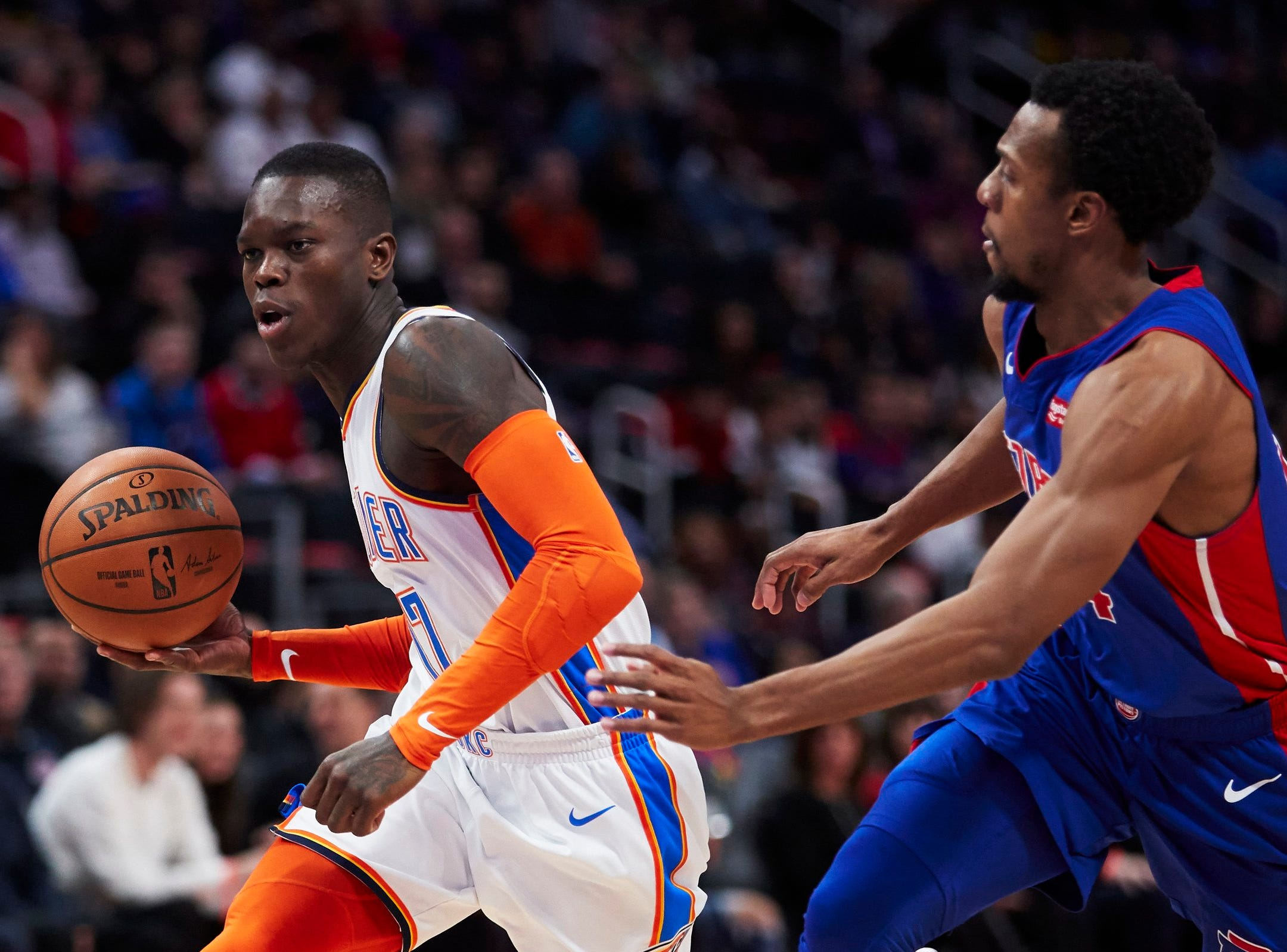 Oklahoma City Thunder guard Dennis Schroder (17) dribbles defended by Detroit Pistons guard Ish Smith (14) in the first half at Little Caesars Arena.