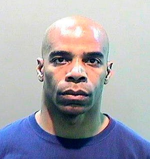 In this Dec. 3, 2018 photo released by Wayne County Prosecutors Office, Dewayne Jones is shown in Detroit. Jones, a Detroit Police Department Corporal, has been charged in the beating of a naked, unarmed and possibly mentally ill woman inside an emergency room triage unit. The Wayne County prosecutor's office says Monday that 47-year-old Jones was arraigned Tuesday on felony misconduct and misdemeanor assault and battery.