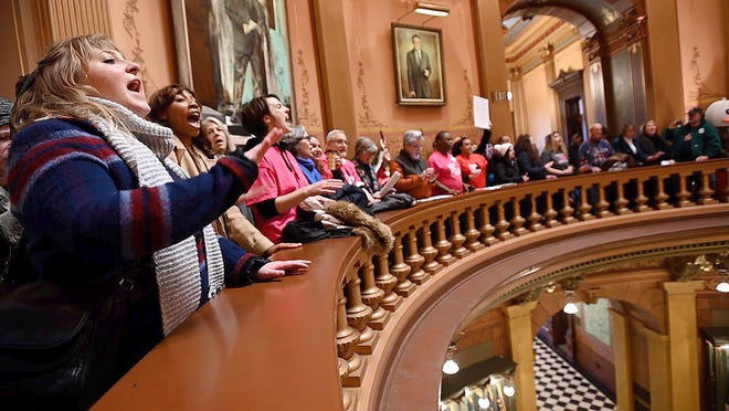"Chanting demonstrators jam the second floor of the Rotunda at the Capitol on Tuesday, Dec. 4, 2018, to protest legislation being considered in the ""Lame Duck"" sessions of the House and Senate. A controversial Senate bill, which would delay phase in of a $12 minimum wage for most workers and scrap plans to ensure equal pay for tipped workers, was passed by the House competitiveness committee Tuesday in the second week of the Legislature's lame duck session."