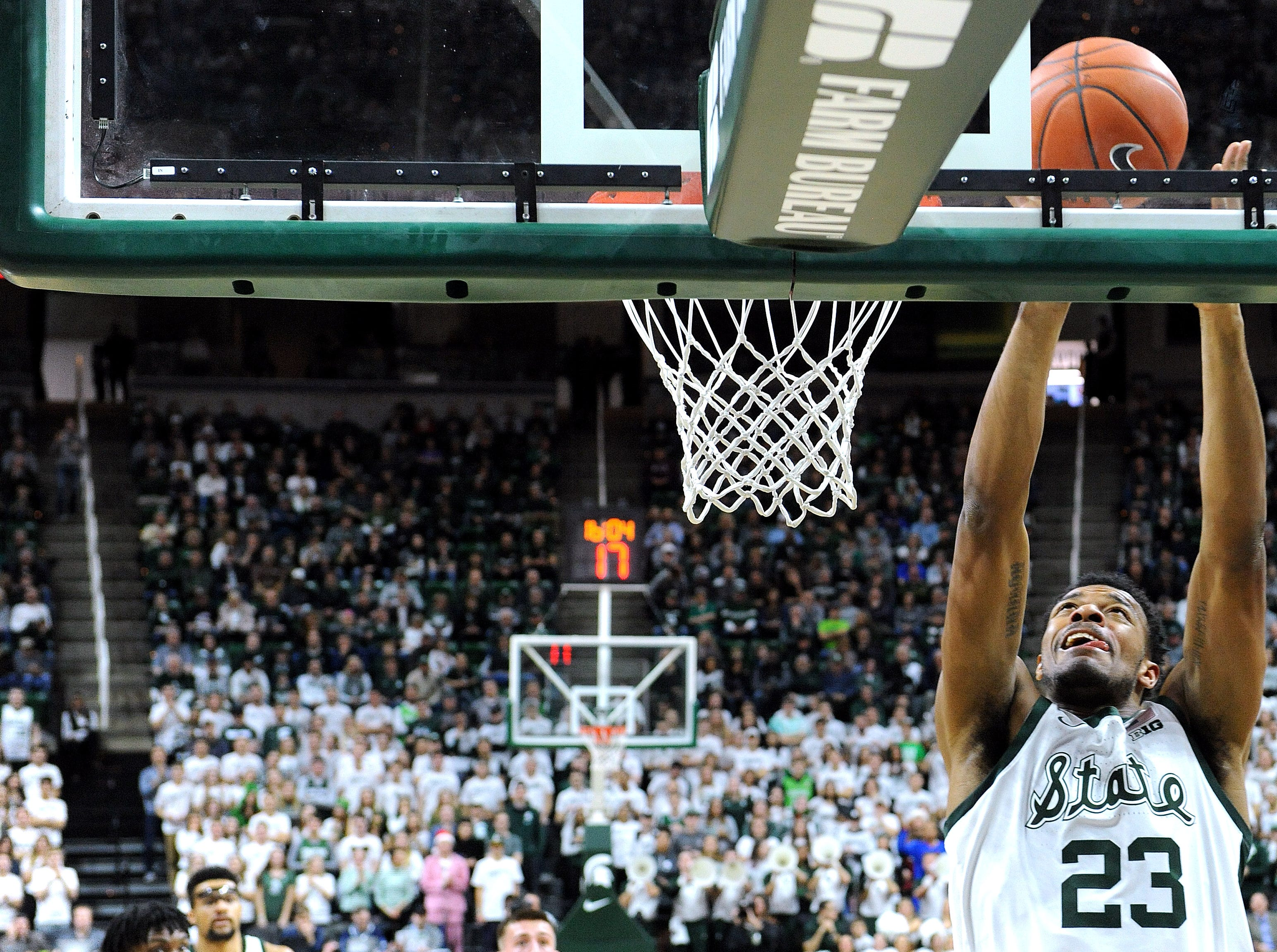 Xavier Tillman concentrates on getting an offensive rebound in the first half.