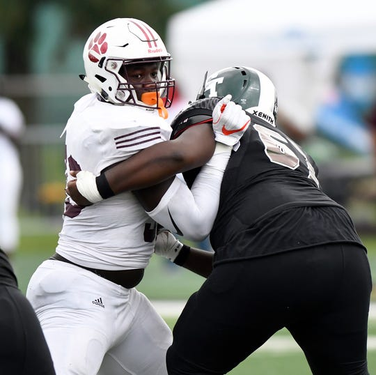 River Rouge defensive end Ruke Orhorhoro (left) had 50 tackles, including 20 tackles for loss and 12 sacks. He scored two touchdowns, forced a fumble and recovered two fumbles.