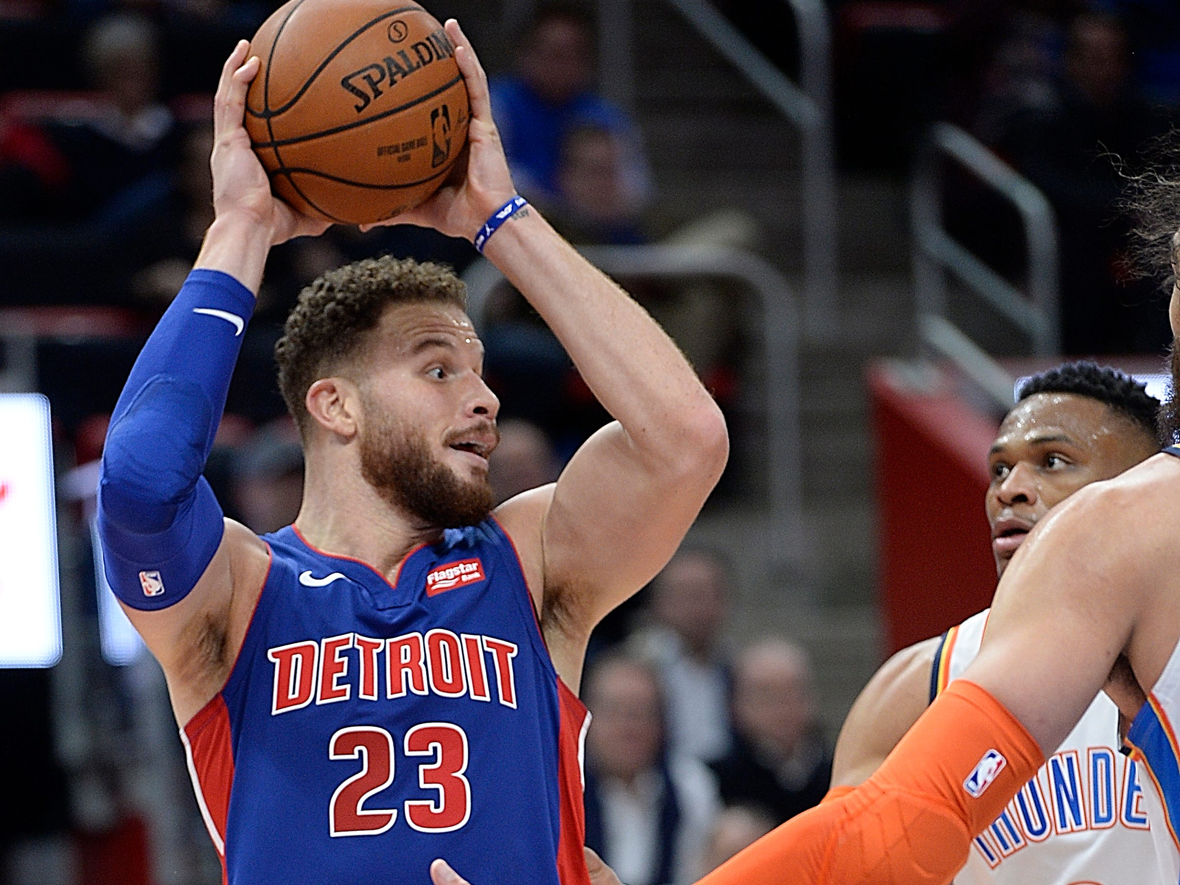 Pistons' Blake Griffin looks for room around Thunder's Russell Westbrook in the second quarter.