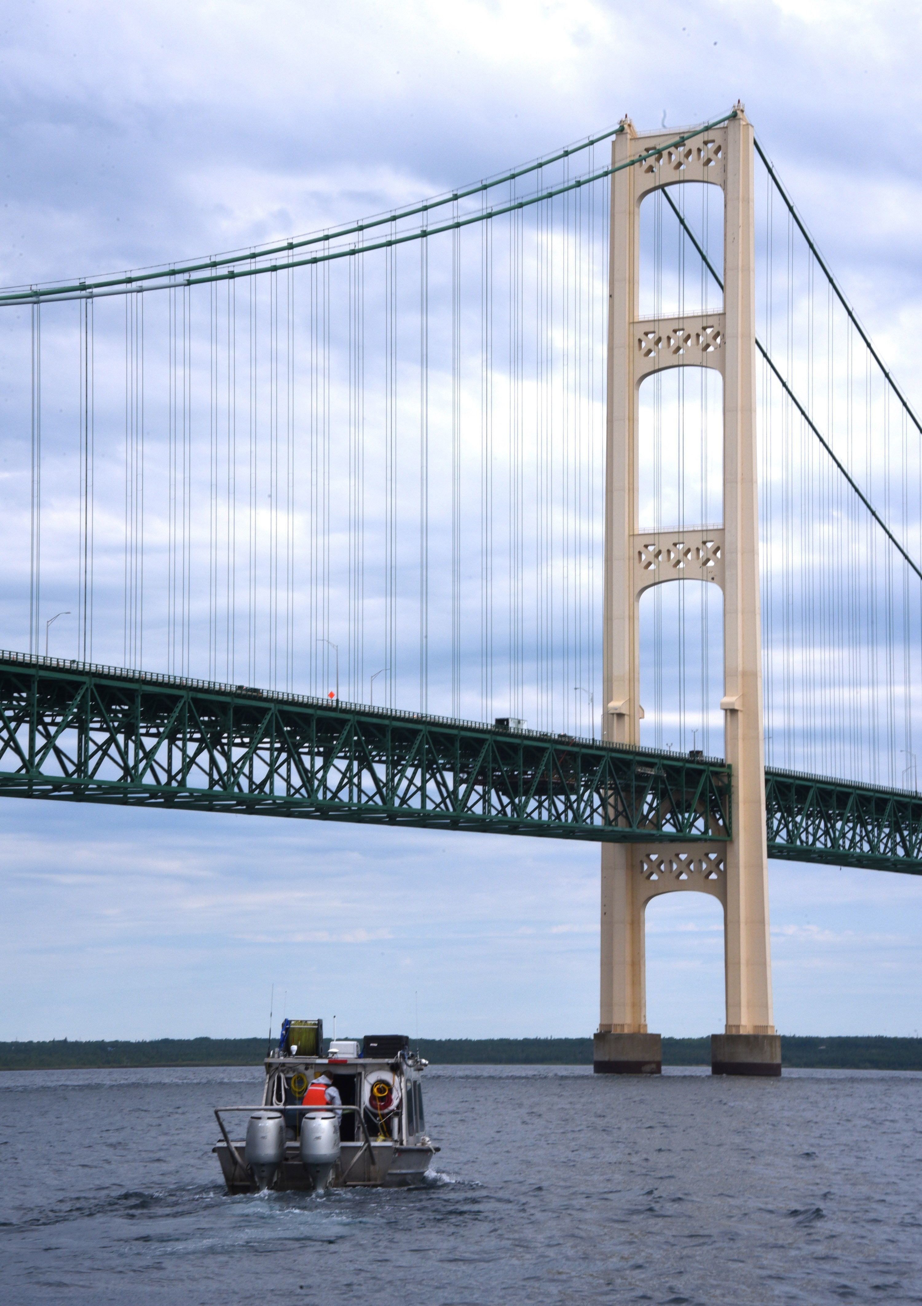 Oil pipeline operator Enbridge moves under the Mackinac Bridge on their way to inspect their controversial Line 5 under the Straits of Mackinac on June 8, 2016.