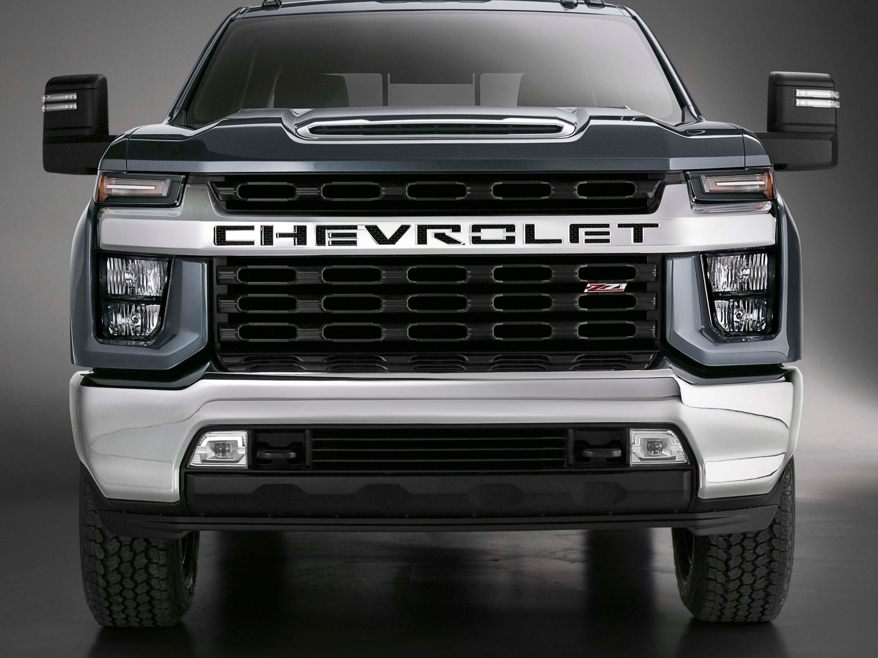 "The 2020 Chevy Silverado Heavy Duty brings a bold new face with lower headlights, a mesh grille, and LED ""eyebrow"" running lights."