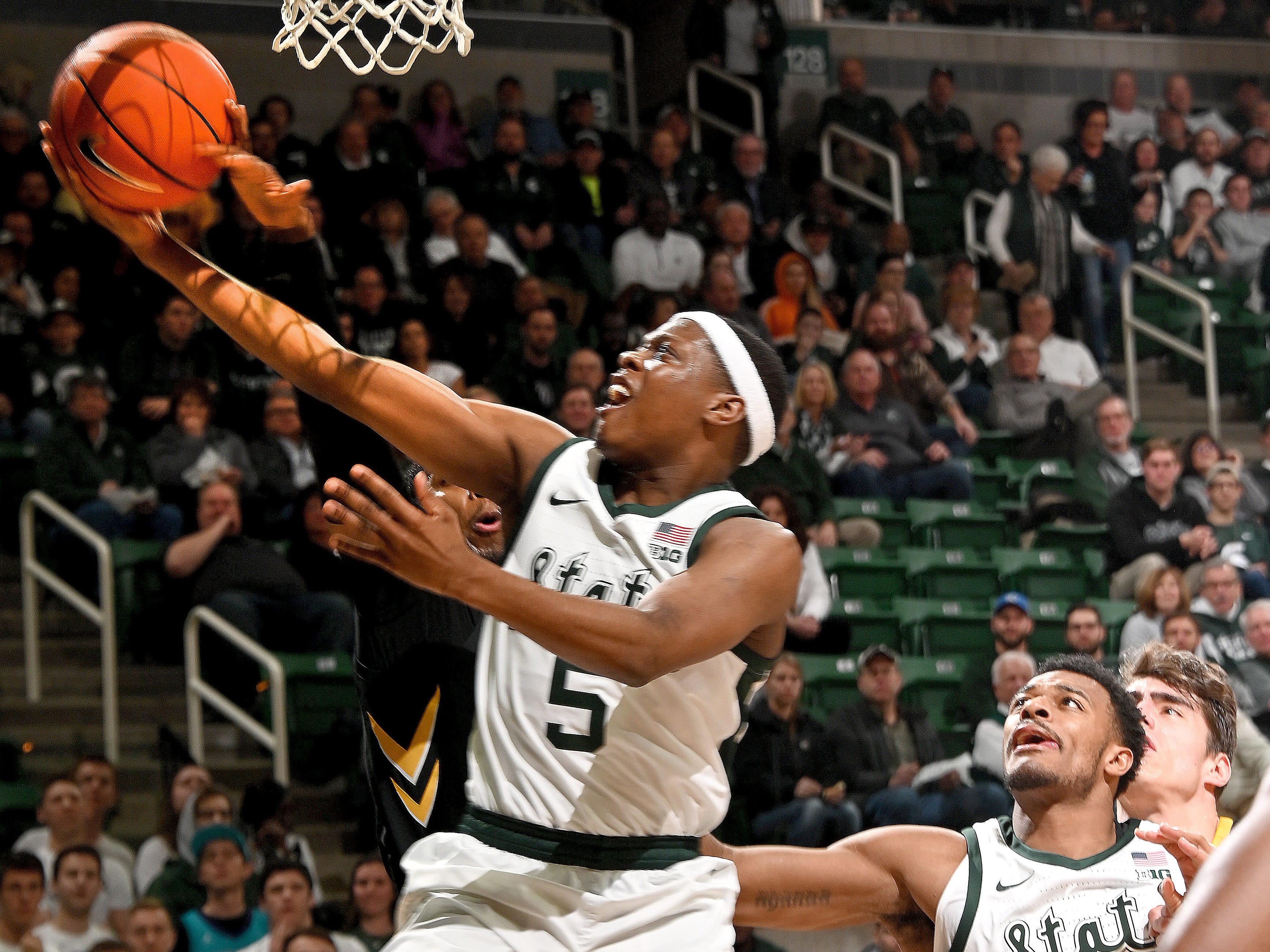 Cassius Winston slashes to the basket in the first half as MSU beats Iowa 90-68, at Breslin Center in East Lansing, Monday night, December 03, 2018.