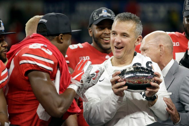 Ohio State head coach Urban Meyer celebrates winning the Big Ten championship. He is retiring after the Rose Bowl.