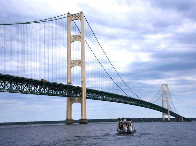 Oil pipeline operator Enbridge moves under the Mackinac Bridge on their way to inspect their controversial Line 5 under the Straits of Mackinac Wednesday, June 8, 2016. Using an autonomous underwater vehicle and a roving underwater vehicle over several days, the entire five-mile-long pipeline, which rests on supports along the bottom of Lake Michigan, will have been covered by both sonar and visual means.