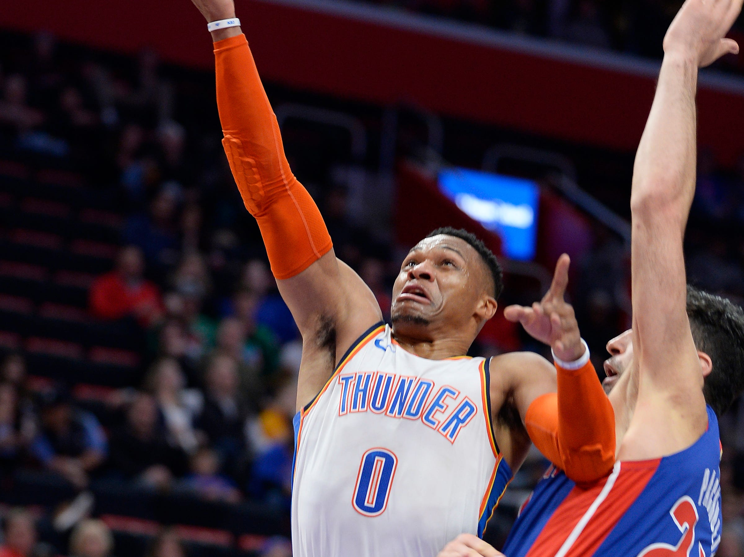 Thunder's Russell Westbrook scores over Pistons' ZaZa Pachulia in the third quarter.