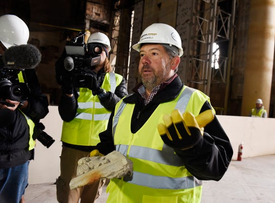 Rich Bardelli of Ford Motor Co. is seen holding and talking about Gaustavino tile inside the Michigan Central Station that is the oldest and largest in any building in the state of Michigan.