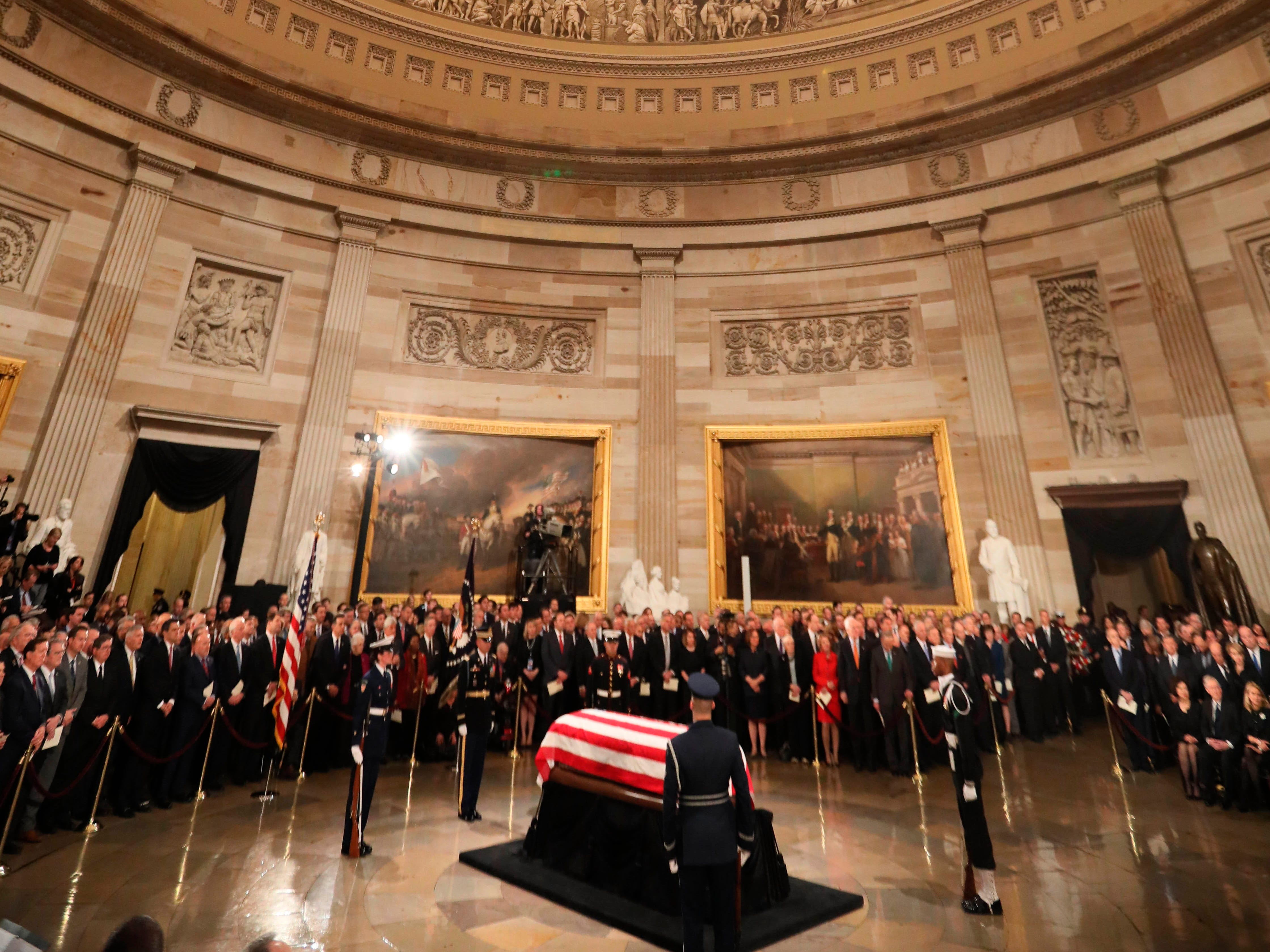 The casket of former President George H.W. Bush arrives at the Capitol in Washington.