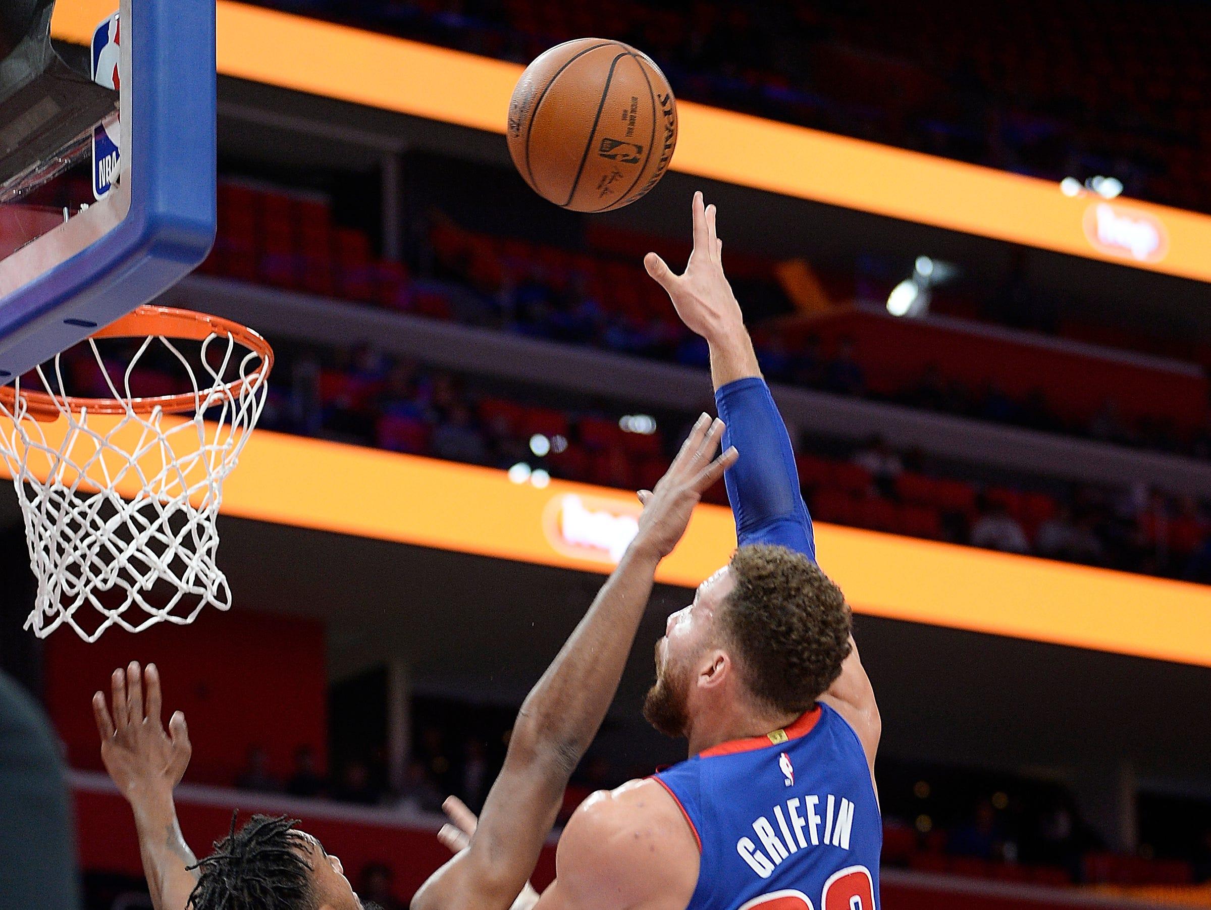 Pistons' Blake Griffin scores over Thunder's Terrance Ferguson in the first quarter.