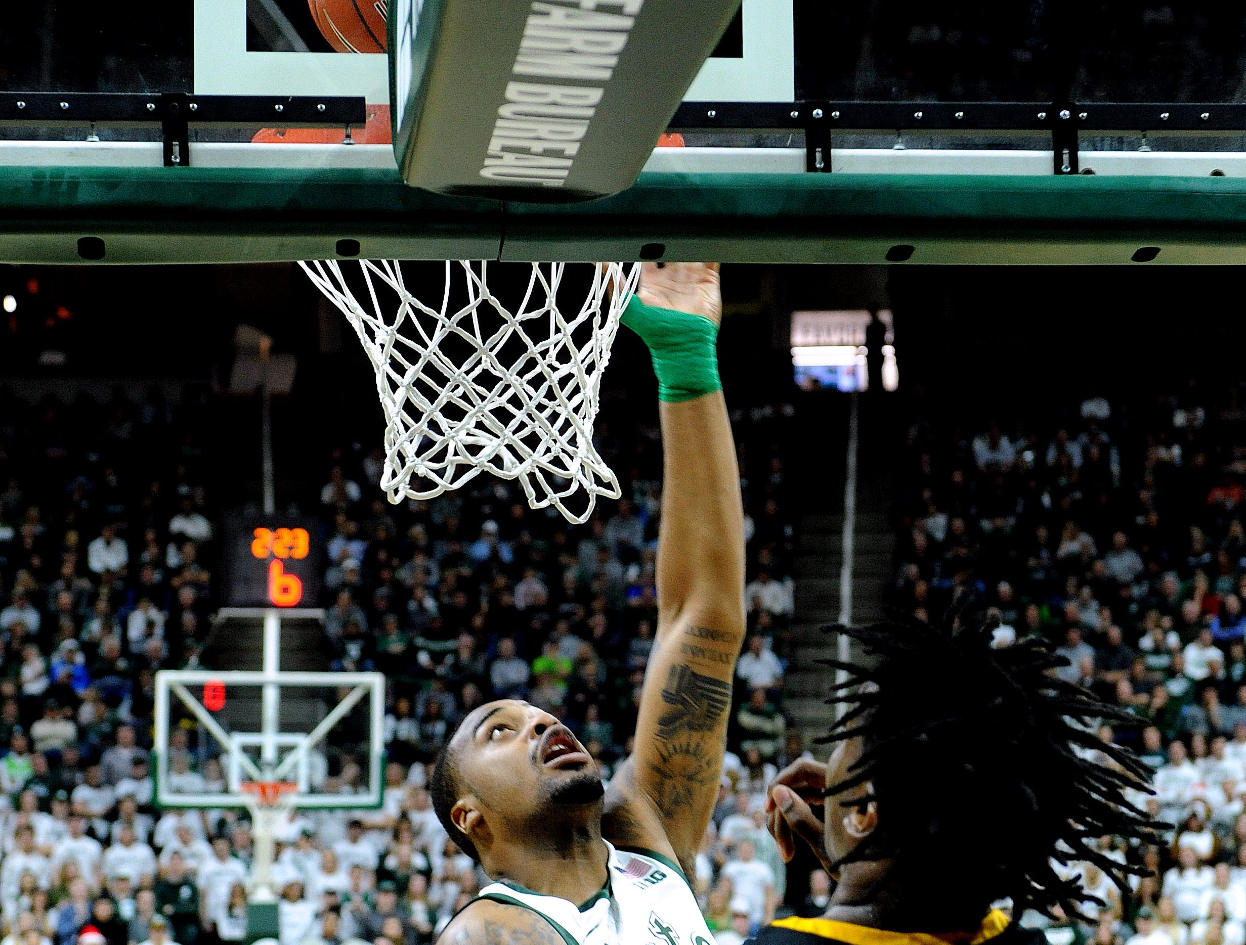 Nick Ward puts back a rebound for two points in the first half.