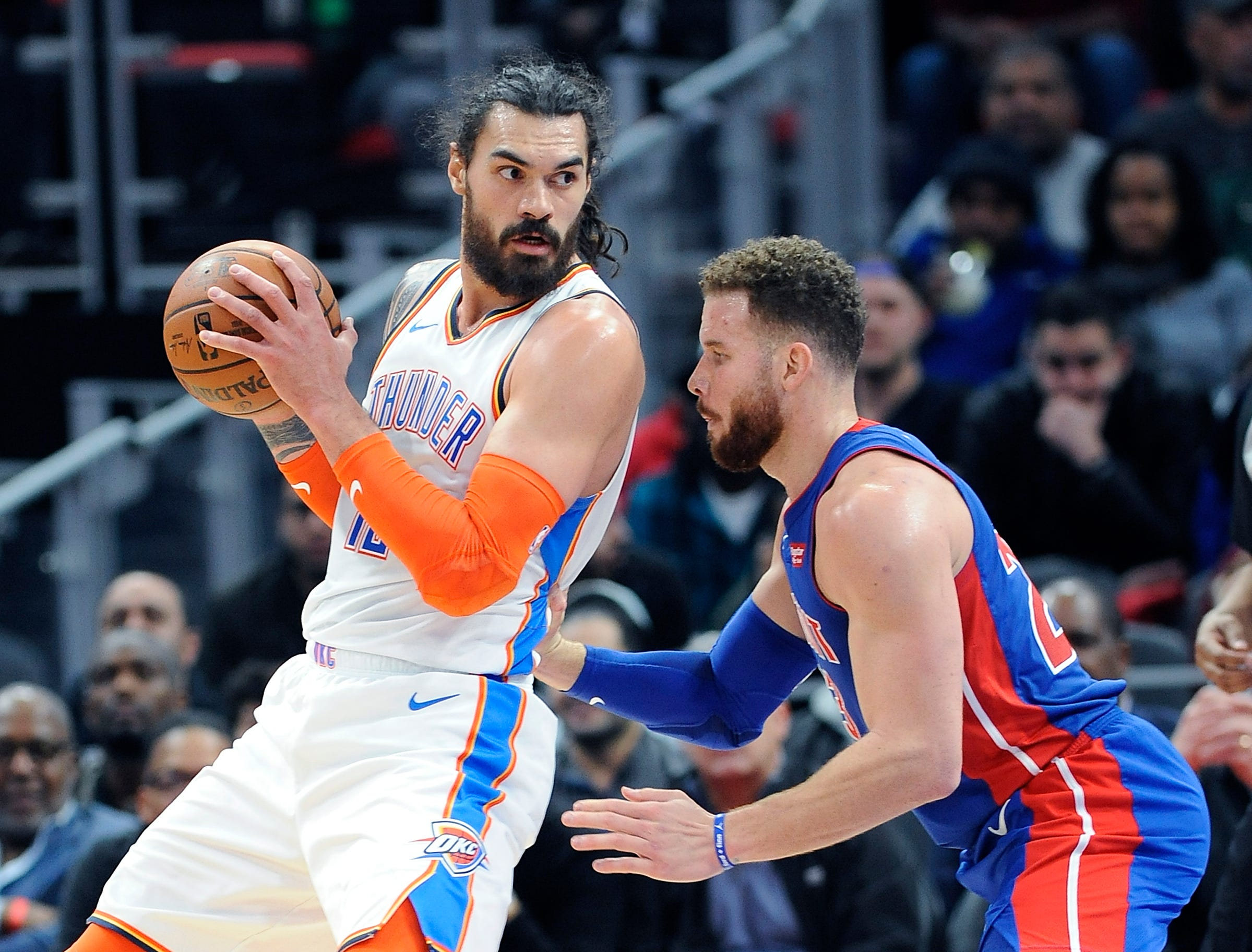 Thunder's Steven Adams looks for room around Pistons' Blake Griffin in the second quarter.