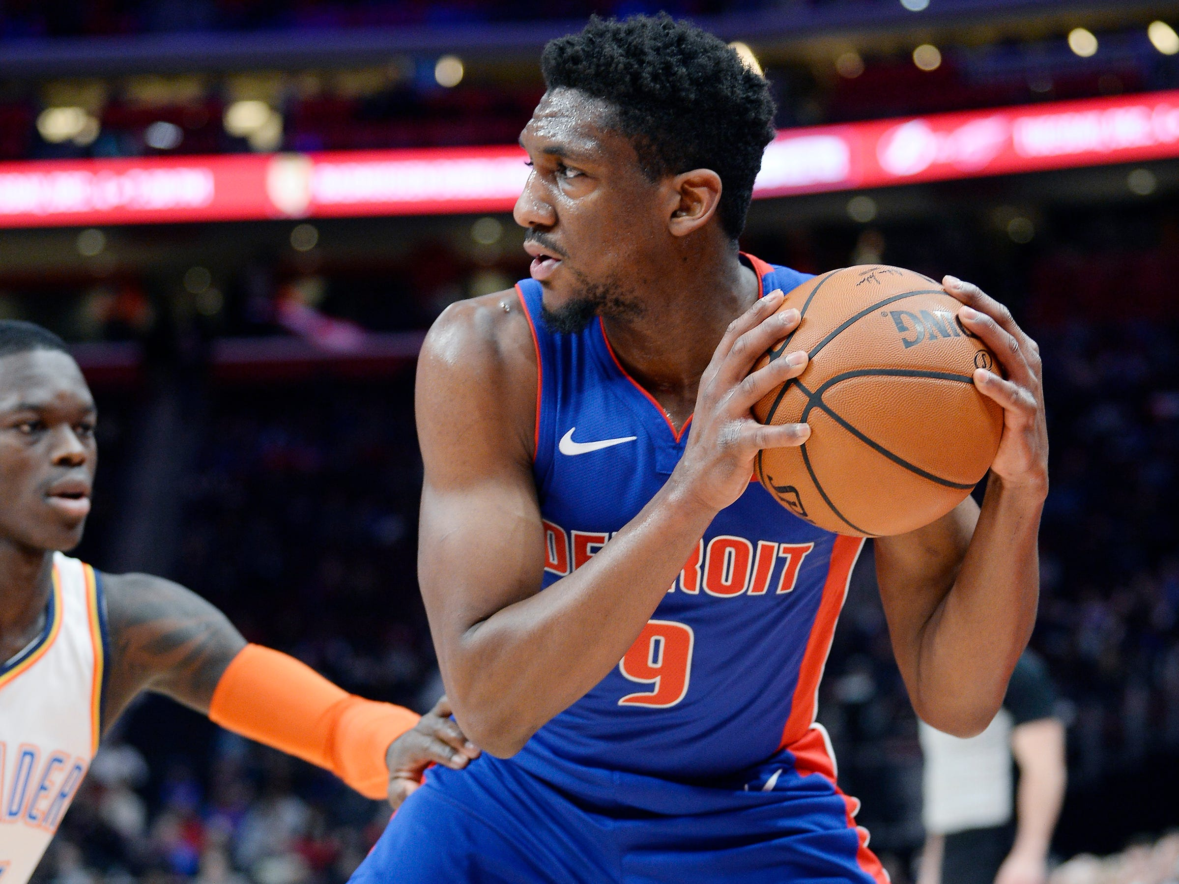 Pistons' Langston Galloway looks for room around Thunder's Dennis Schroder in the second quarter.